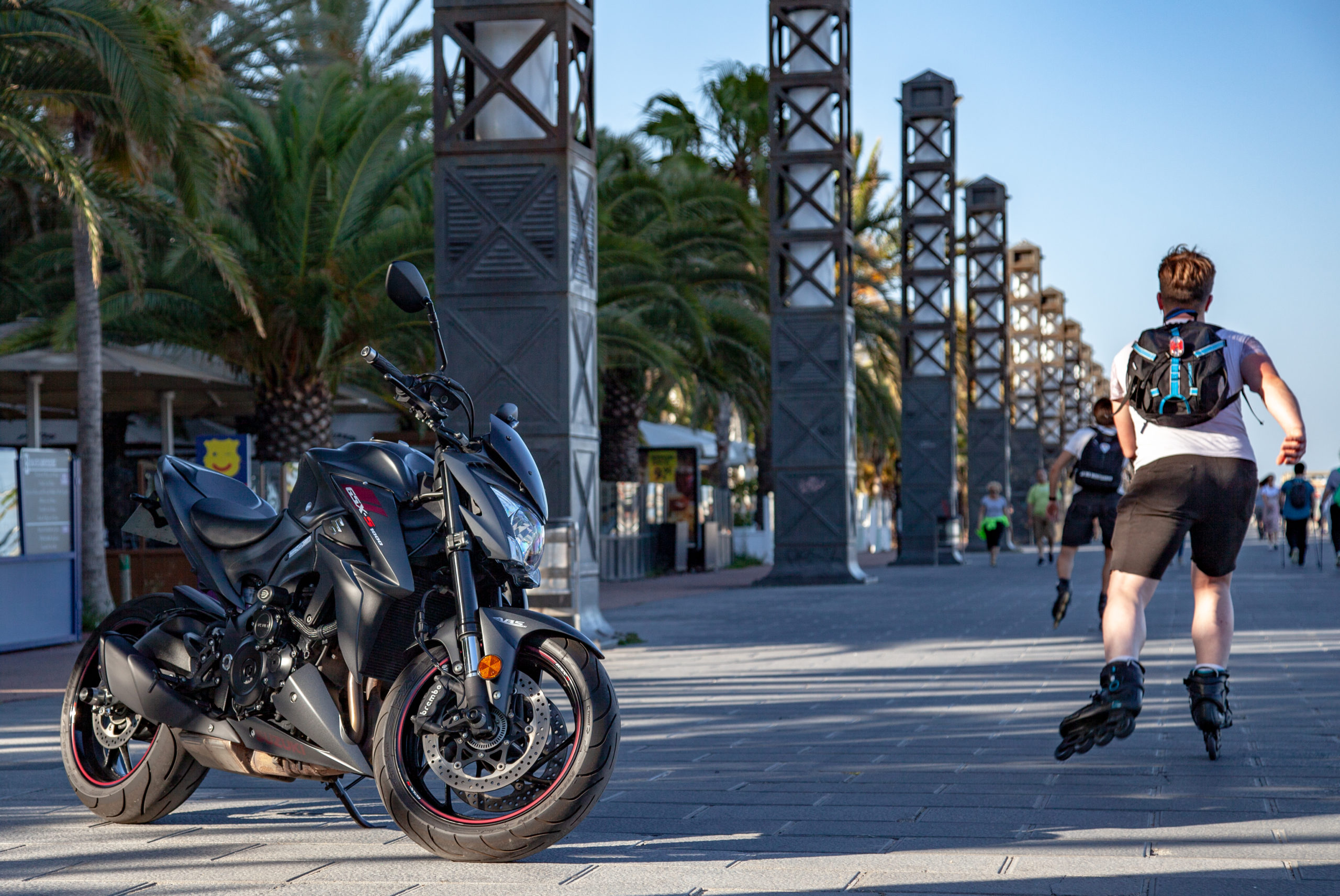 motorcycle with man rollerblading in spain